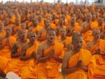 Thai buddhist monks pray as they attend a ceremony to mark their passage into monkhood. AFP