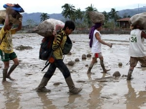 Homeless flood survivors walk toward the gymnasium in the southern Philippine township of New Bataan in Compostela province on December 5, 2012 after the strongest typhoon Bopha pounded the island on Tuesday, leaving several deaths and and missing. INQUIRER FILE PHOTO