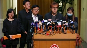 Tse Chi-kin, second from right, brother of killed hostage Masa Tse, is accompanied with hostage survivor and victims' family members during a news conference in Hong Kong Wednesday, April 23, 2014. Hong Kong and the Philippines reached a compromise Wednesday over Hong Kong's demands for an apology for the families of eight tourists killed in a bungled response to a 2010 Manila hostage-taking that soured relations. (AP Photo/Kin Cheung)