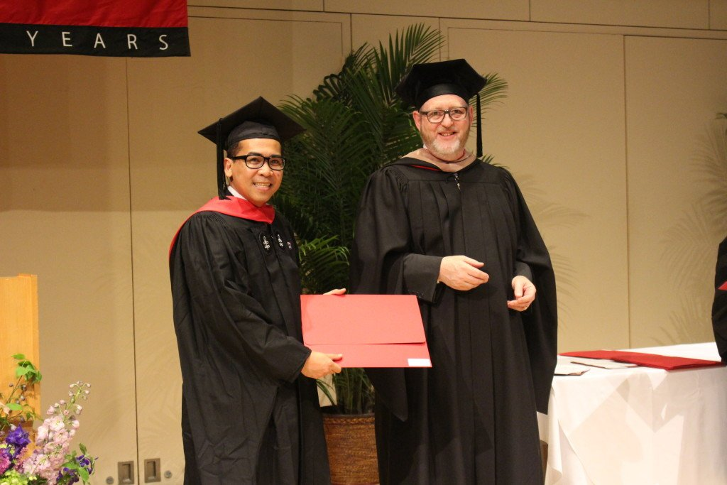 Michael Ubac receiving his Harvard diploma and Director's Prize for Best Thesis from the Dean of Harvard Continuing Education and Extension School, Huntington Lambert.